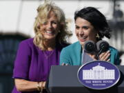 First lady Jill Biden comes over to comfort 2021 National Teacher of the Year Juliana Urtubey, a bilingual special education teacher in Las Vegas, who was emotional as she spoke during an event with 2020 and 2021 State and National Teachers of the Year on the South Lawn of the White House in Washington, Monday, Oct. 18, 2021.