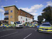 Emergency services at the scene near the Belfairs Methodist Church in Eastwood Road North, where Conservative MP Sir David Amess has reportedly been stabbed several times at a constituency surgery, in Leigh-on-Sea, Essex, England, Friday, Oct. 15, 2021. British police and media reports said that Conservative lawmaker David Amess was stabbed during a meeting with constituents in eastern England on Friday. A man has been arrested.