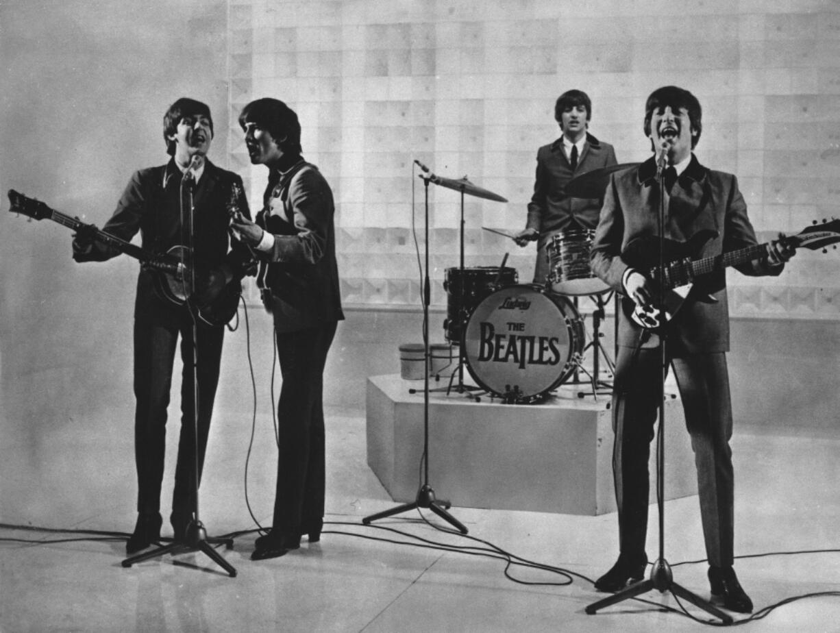 """FILE - The Beatles are seen performing, date unknown. From left to right: Paul McCartney, George Harrison, Ringo Starr, and John Lennon. McCartney has revisited the breakup of The Beatles, refuting the suggestion that he was responsible for the group's demise. Speaking on an episode of BBC Radio 4's """"This Cultural Life'' that is scheduled to air Oct 23, McCartney said it was John Lennon who wanted to disband The Beatles."""