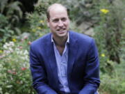 FILE - In this Thursday, July 16, 2020 file photo, Britain's Prince William speaks with service users during a visit to the Garden House in Peterborough, England. Prince William has criticized some of the world's richest men for using their wealth to fund a new space race and space tourism, and called on the world's great minds to fix the planet first. The Duke of Cambridge spoke to the BBC about climate anxiety, COP26, space travel, and his family's long-standing commitment to environmental issues ahead of his inaugural Earthshot prize awards ceremony Sunday, Oct.