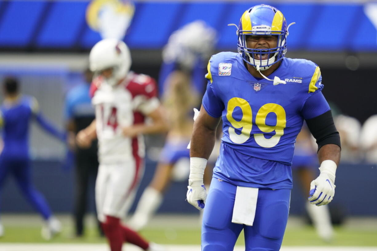 Los Angeles Rams defensive end Aaron Donald (99) will once again give chase to Seattle Seahawks quarterback Russell Wilson.