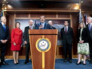 FILE - In this Oct. 6 2021, file photo Sen. Ted Cruz, R-Texas, accompanied by from left, Sen. Rick Scott, R-Fla., Sen. Shelley Moore Capito, R-W.Va., and Sen. John Hoeven, R-N.D., Sen. Chuck Grassley, R-Iowa, Sen. Todd Young, R-Ind., Sen. Joni Ernst, R-Iowa, and Sen. John Cornyn, R-Texas, speaks at a news conference on Capitol Hill in Washington to speak about immigration at the U.S.- Mexico boarder. About 36% of President Joe Biden's nominees have been confirmed by the Senate so far in the evenly divided Senate, a deterioration from the paltry 38% success rate that former President Donald Trump saw at the same stage of his presidency.