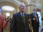 Senate Minority Leader Mitch McConnell, R-Ky., is surrounded by journalists as he walks to the Senate Chamber for a vote as Democrats look for a way to lift the debt limit without Republican votes, at the Capitol in Washington, Wednesday, Oct. 6, 2021. (AP Photo/J.