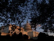 FILE - The U.S Capitol at sunset in Washington, on Sept. 30, 2021. Year-end pileups of crucial legislation and the brinkmanship that goes with it are annual rituals for Congress. But this time, testy lawmakers are barreling toward an autumn of battles that are striking for the risks they pose to both parties and their leaders. Miscalculate and there could be a calamitous federal default, a collapse of Biden's domestic agenda and, for good measure, a damaging government shutdown.
