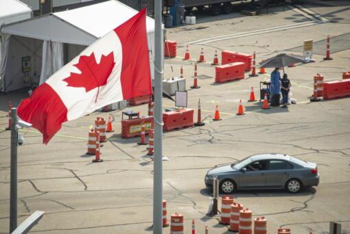 A car crosses the border into Canada, in Niagara Falls, Ontario, on Aug. 9.