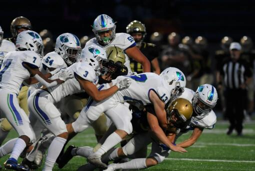 A host of Mountain View defenders combine to take down Kelso tailback Conner Noah in the first quarter of MV's 20-17 win over the Hilanders at Schroeder Field on Oct.
