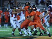 Washougal's Will Cooper gains yards against R.A. Long on Friday.