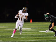 Niyjiel Brown (11) of Hudson's Bay, gets around on a Woodland defender during Friday's game at Woodland.