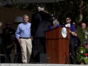 """FILE - Blackhawk pilot Michael Durant, who was held prisoner in Somalia, is welcomed to the podium during Bonita Springs' Veterans Day memorial service at Riverside Park in Bonita Springs, Fla., in this Tuesday, Nov. 11, 2014, file photo. Mike Durant, best known as the helicopter pilot shot down and held prisoner in the 1993 """"Black Hawk Down"""" incident, is joining the U.S. Senate race in Alabama. Durant, now the founder and president of an aerospace company in Huntsville, announced his campaign Tuesday, Oct. 19, 2021."""