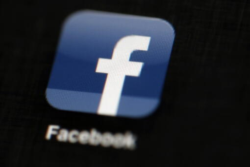 FILE - This May 16, 2012, file photo, shows the Facebook logo displayed on an iPad. Facebook in India dithered in curbing hate speech and anti-Muslim content on its platform and lacked enough local language moderators to stop misinformation that at times led to real-world violence, according to leaked documents obtained by The Associated Press.