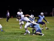 Hockinson's Hale Prior (7) is spun around as he breaks free of a Mark Morris defender on Friday, Oct. 15, in Longview.