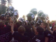 Heritage football players celebrate their 16-13 win over Evergreen on Thursday, Oct.