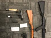 Clark County sheriff's deputies seized several firearms, ammunition and accessories Friday, including a handgun and ammunition of the same caliber used in the Sept. 22 drive-by shooting on Northeast Padden Parkway.