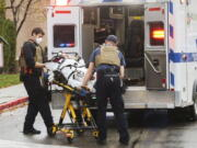 First responders take care of people who were inside the Boise Towne Square shopping mall when a man opened fire at the mall Monday, Oct. 25, 2021, in Boise, Idaho.