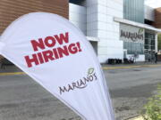 A sign in the parking lot of Mariano's grocery store advertises the availability of jobs Friday, Oct. 8, 2021, in Chicago.  One reason America's employers are having trouble filling jobs was starkly illustrated in a report Tuesday, Oct. 12: Americans are quitting in droves.