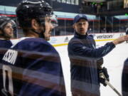 Seattle Kraken head coach Dave Hakstol discusses a drill with players during training camp at Kraken Community Iceplex last month in Seattle.