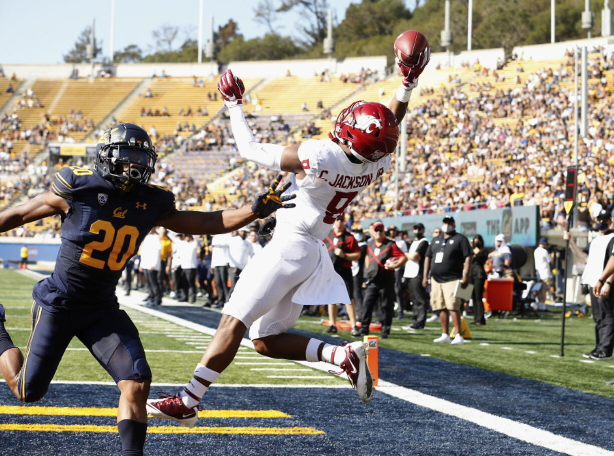 Washington State Cougars wide receiver Calvin Jackson Jr. (8) catches a touchdown pass in front of California Golden Bears cornerback Josh Drayden (20) in the first quarter during an NCAA football game on Saturday, Oct. 2, 2021 in Berkeley, Calif.