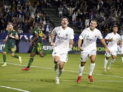 LA Galaxy midfielder Sacha Kljestan, center, celebrates after scoring on a penalty kick during the second half against the Portland Timbers in an MLS soccer match Saturday, Oct. 16, 2021, in Carson, Calif.