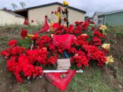A memorial for the suspect killed by Clark County Sheriff's deputies early Sunday morning sprung up by Sunday afternoon on 49th Street in east Vancouver.