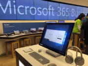 FILE - In this Jan. 28, 2020, file photo, a Microsoft computer is among items displayed at a Microsoft store in suburban Boston. Microsoft says the same Russia-backed hackers responsible for the 2020 SolarWinds breach continue to attack the global technology supply chain and are have been relentlessly targeting cloud service resellers and others since summer.