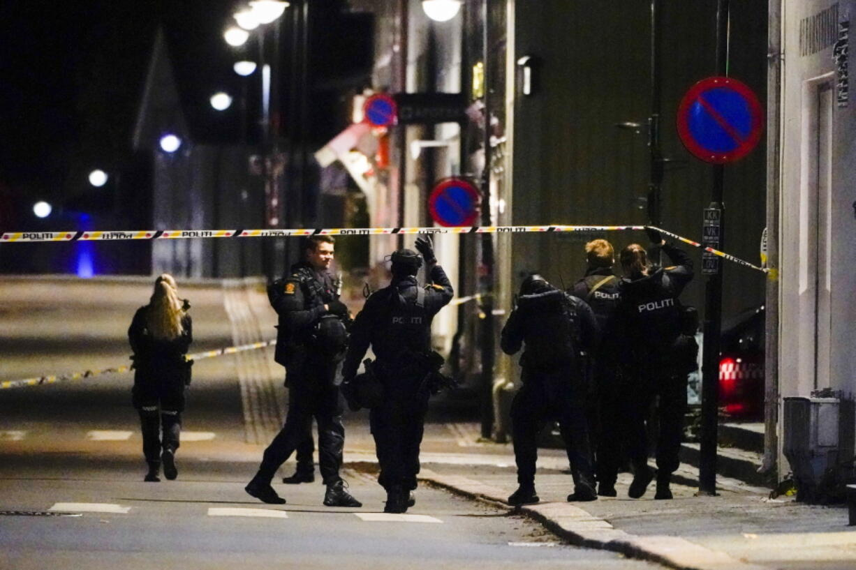 Police stand at the scene after an attack in Kongsberg, Norway, Wednesday, Oct. 13, 2021. Several people have been killed and others injured by a man armed with a bow and arrow in a town west of the Norwegian capital, Oslo.