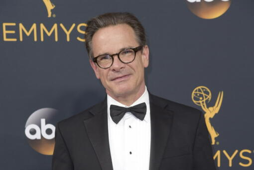 """FILE - Peter Scolari arrives at the 68th Primetime Emmy Awards in Los Angeles on Sept. 18, 2016. Scolari, a versatile character actor whose television roles included a yuppie producer on """"Newhart"""" and a closeted dad on """"Girls"""" and who was on Broadway in """"Hairspray"""" and """"Wicked,"""" died Friday morning in New York after fighting cancer for two years, according to Ellen Lubin Sanitsky, his longtime manager. He was 66."""
