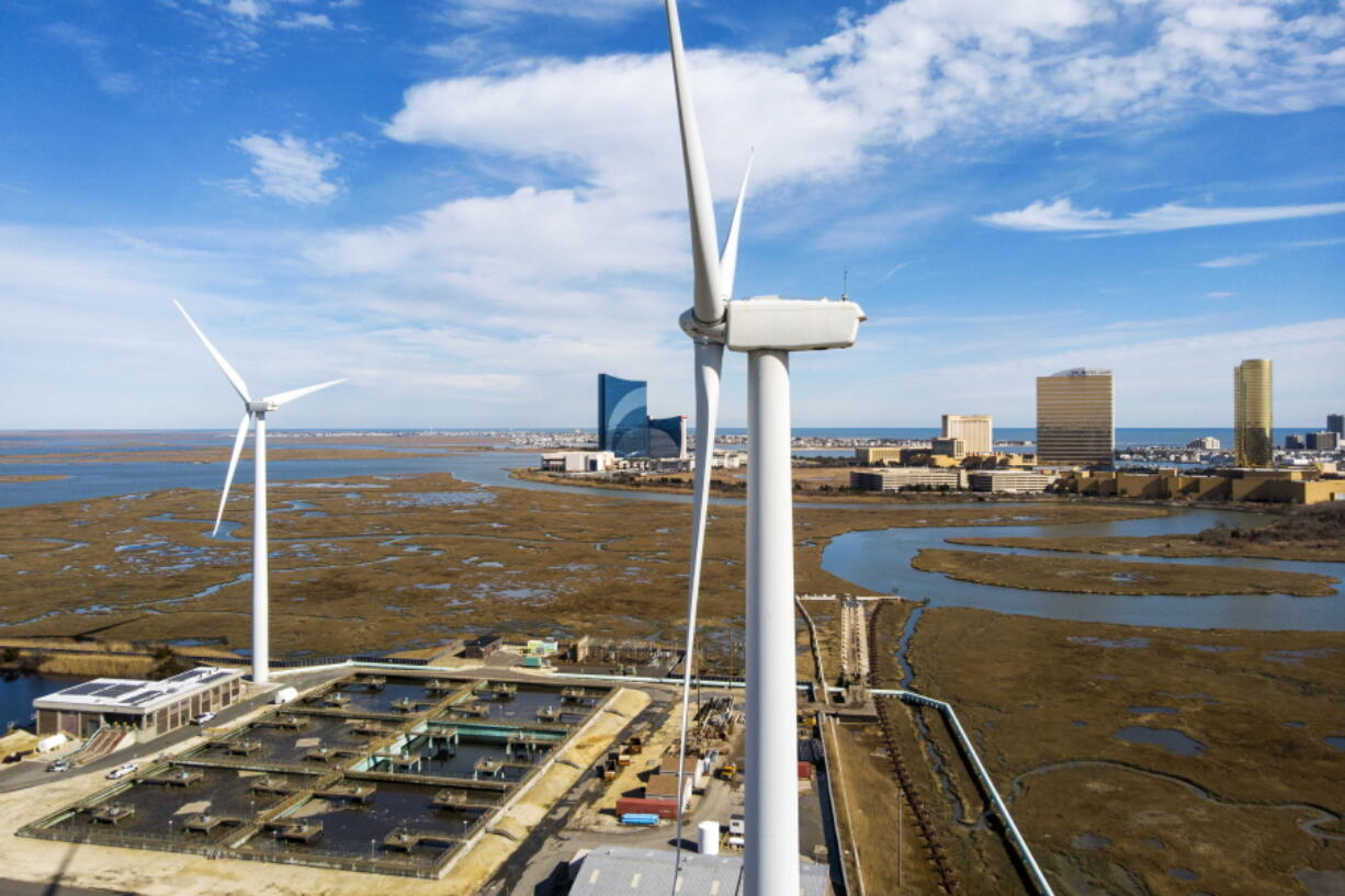 FILE - Wind turbines spin to generate electrical power in Atlantic City, N.J., on Wednesday, Feb. 17, 2021. A report released Tuesday, Oct. 12 by a group studying the economics of the offshore wind industry predicts that the industry's supply chain will be worth $109 billion over the next decade.