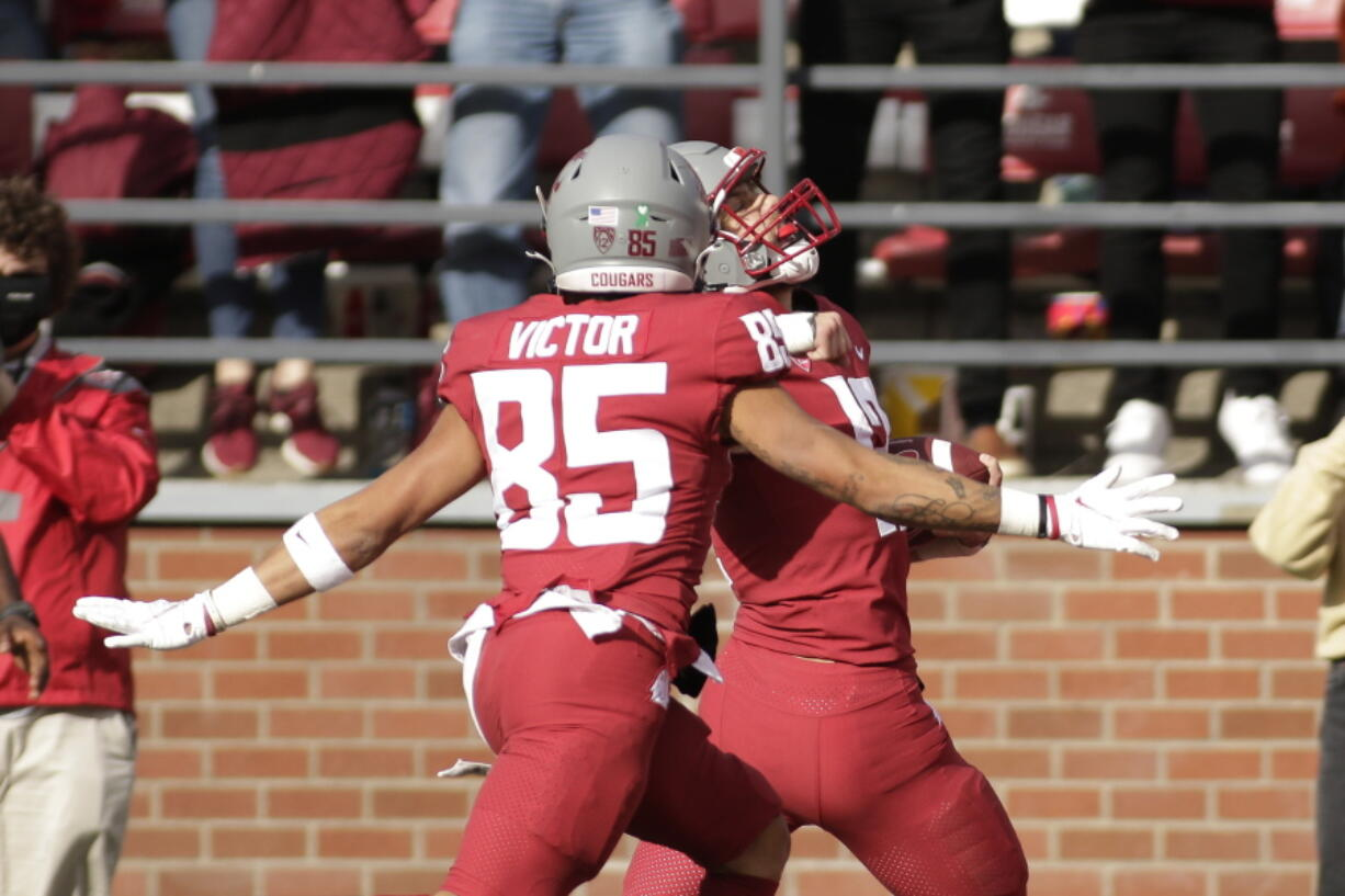 Washington State wide receiver Joey Hobert, right, celebrates as he runs for a touchdown, with wide receiver Lincoln Victor, a Union High grad, during the second half against Oregon State, Saturday, Oct. 9, 2021, in Pullman. Washington State won 31-24.