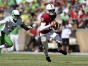 Stanford's Tanner McKee runs with the ball against Oregon during the first half of an NCAA college football game in Stanford, Calif., Saturday, Oct. 2, 2021.