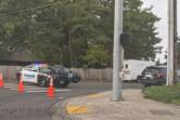 Police cars block the scene of a shooting involving Clark County sheriff's deputies that left an assault suspect dead.