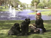 Penny Wagner appears with her two dogs, Clarence, left, and Cooper in Albuquerque, N.M., on April 8, 2020.