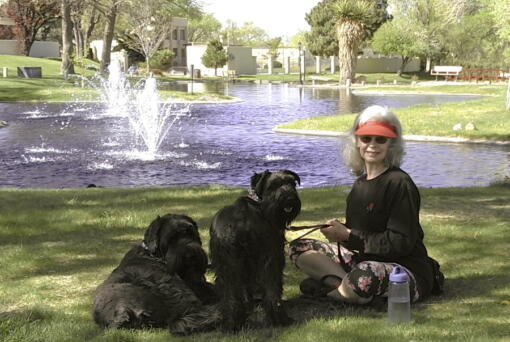 Penny Wagner appears with her two dogs, Clarence, left, and Cooper in Albuquerque, N.M., on April 8, 2020. (Steve Wagner)
