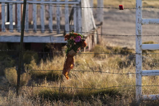 A bouquet of flowers is left to honor cinematographer Halyna Hutchins outside the Bonanza Creek Ranch in Santa Fe, N.M., Sunday, Oct. 24, 2021. Hutchins died after actor Alec Baldwin fired a fatal gunshot from a prop gun that he had been told was safe. (AP Photo/Jae C.