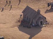 This aerial video image provided by KOAT 7 News, shows Santa Fe County Sheriff's Officers responding to the scene of a fatal accidental shooting at a Bonanza Creek, Ranch movie set near Santa Fe, N.M. Thursday, Oct. 21, 2021. Authorities say a woman has been killed and a man injured Thursday after they were shot by a prop firearm at a movie set outside Santa Fe. The Santa Fe County Sheriff's Office says a 42-year-old woman was airlifted to a hospital, where she died, while a 42-year-old man was getting emergency care at another hospital.