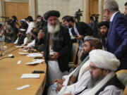 Members of the political delegation from the Afghan Taliban's movement attend talks involving Afghan representatives in Moscow, Russia, Wednesday, Oct. 20, 2021. Russia invited the Taliban and other Afghan parties for talks voicing hope they will help encourage discussions and tackle Afghanistan's challenges.