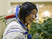 Space flight participant Yusaku Maezawa attends a training session ahead of the expedition to the International Space Station at the Gagarin Cosmonauts' Training Center in Star City outside Moscow, Russia, Thursday, Oct. 14, 2021. A Japanese fashion tycoon who's booked a SpaceX ride to the moon is going to try out the International Space Station first. Yusaku Maezawa announced that he's bought two seats on a Russian Soyuz capsule. He'll blast off in December on the 12-day mission with his production assistant and a professional cosmonaut.