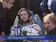 In this photo taken from video footage released by Roscosmos Space Agency, actress Yulia Peresild sits in a chair shortly after the landing of the Russian Soyuz MS-18 space capsule, southeast of the Kazakh town of Zhezkazgan, Kazakhstan, Sunday, Oct. 17, 2021. The Soyuz MS-18 capsule landed upright in the steppes of Kazakhstan on Sunday with cosmonaut Oleg Novitskiy, actress Yulia Peresild and film director Klim Shipenko aboard after a 3 1/2-hour trip from the International Space Station.