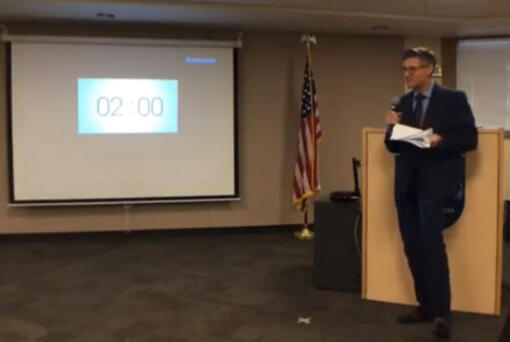 Washougal physician assistant Scott Miller speaks against COVID-19 safety precautions such as mask mandates and distance-learning during a Camas School Board meeting on May 10, 2021.