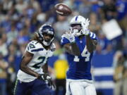 Indianapolis Colts wide receiver Zach Pascal (14) makes catch for a touchdown in front of Seattle Seahawks cornerback Tre Flowers (21) during the second half of an NFL football game in Indianapolis, Sunday, Sept. 12, 2021.