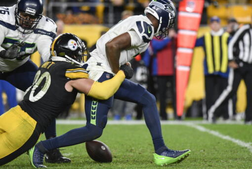 Seattle Seahawks quarterback Geno Smith (7) fumbles as Pittsburgh Steelers outside linebacker T.J. Watt (90) tackles him during overtime of an NFL football game, Sunday, Oct. 17, 2021, in Pittsburgh. The Steelers won 23-20 in overtime.
