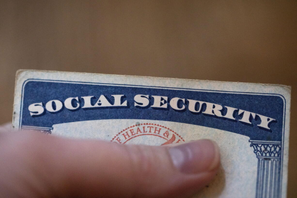 This Tuesday, Oct. 12, 2021, photo shows a Social Security card in Tigard, Ore.  Millions of retirees on Social Security will get a 5.9% boost in benefits for 2022. The biggest cost-of-living adjustment in 39 years follows a burst in inflation as the economy struggles to shake off the drag of the coronavirus pandemic.