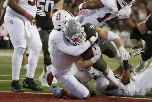 Washington State running back Max Borghi, center right, runs for a touchdown as Stanford linebacker Andres Fox defends during the second half of an NCAA college football game Saturday, Oct. 16, 2021, in Pullman, Wash. Washington State won 34-31.