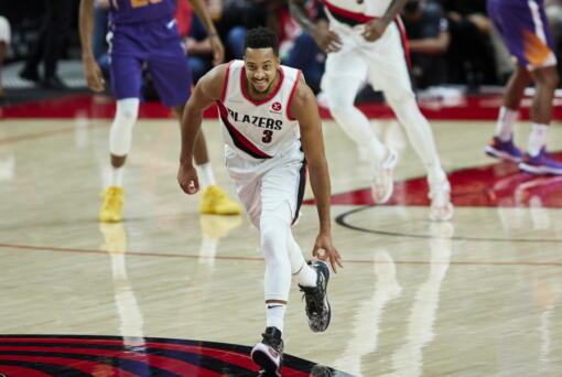 Portland Trail Blazers guard CJ McCollum gestures after making a 3-point basket against the Phoenix Suns during the second half of an NBA basketball game in Portland, Ore., Saturday, Oct. 23, 2021.
