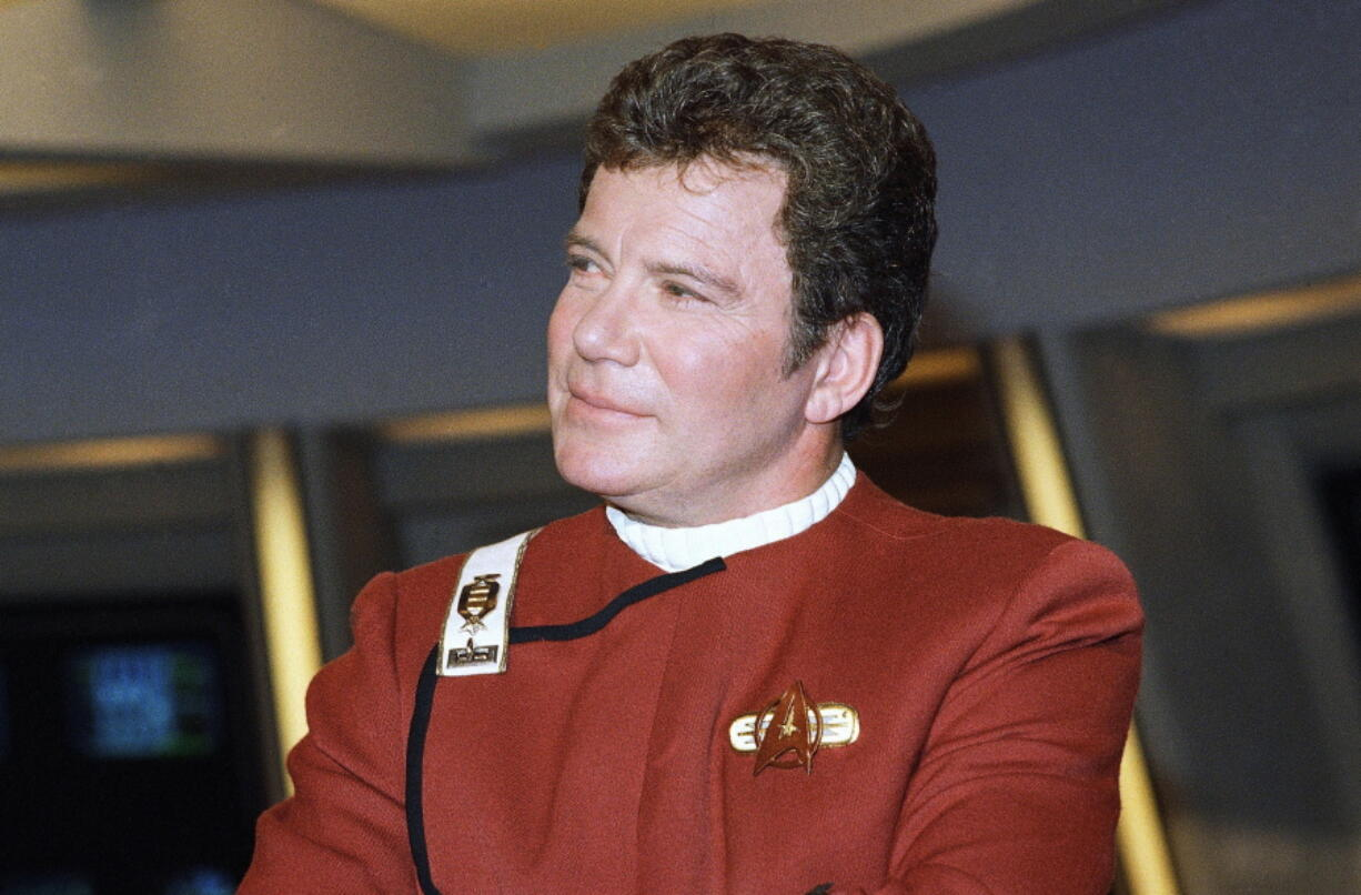"""FILE - In this 1988 file photo, William Shatner, who portrays Capt. James T. Kirk, attends a photo opportunity for the film """"Star Trek V: The Final Frontier."""" The performer who breathed life into Kirk is, at age 90, heading toward the stars under dramatically different circumstances than his fictional counterpart when Shatner boards Jeff Bezos' Blue Origin NS-18."""