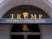 FILE - This March 11, 2019 file photo, shows the north entrance of the Trump International in Washington.  Former President Donald Trump's company lost more than $70 million operating his Washington D.C. hotel while in office, forcing him at one point get a reprieve from a major bank on payments on a loan, according to documents released Friday, Oct. 8, 2021, by a House committee investigating his business.