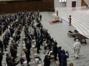 Pope Francis arrives to meet with the participants to the inter-parliamentary meeting on the COP26 in the Paul VI Hall at the Vatican, Saturday, Oct. 9, 2021.