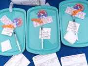 FILE - In this May 19, 2021 file photo, Pfizer COVID-19 vaccine doses are prepared for members of the community 12 years and up, at a clinic held by Community of Hope, outside the Washington School for Girls in southeast Washington. Kids aged 5 to 11 will soon be able to get a COVID-19 shot at their pediatrician's office, local pharmacy and potentially even their school. The White House is detailing plans Wednesday for the expected authorization of the Pfizer shot for younger children in a matter of weeks.