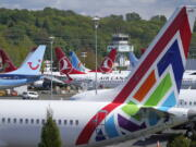 Boeing 737 Max airplanes sit parked in a storage lot in April near Boeing Field in Seattle.