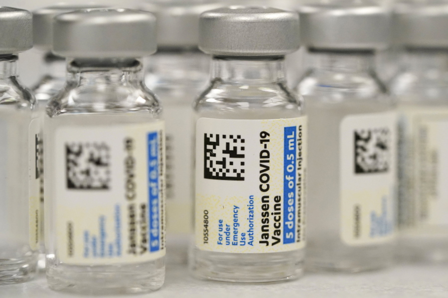 FILE - This Saturday, March 6, 2021, file photo shows vials of Johnson & Johnson COVID-19 vaccine at a pharmacy in Denver. Johnson & Johnson has asked U.S. regulators to allow booster shots of its COVID-19 vaccine as the U.S. government moves toward shoring up protection in more vaccinated Americans. J&J said Tuesday, Oct. 5, 2021, it filed data with the Food and Drug Administration on giving a booster dose between two to six months after vaccination.