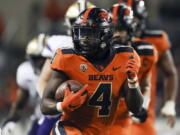 Oregon State running back B.J. Baylor (4) rushes for 27-yards to score a touchdown during the second half of an NCAA college football game against Washington on Saturday, Oct. 2, 2021, in Corvallis, Ore. Oregon State won 27-24.